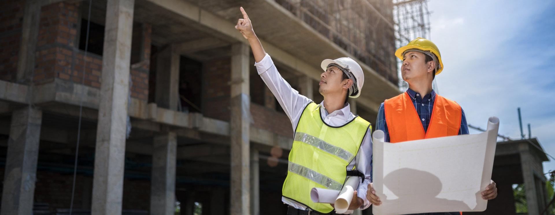 Businessman engineer looking blueprint in a building